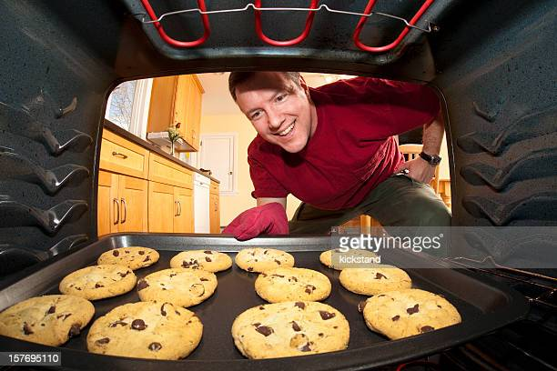 A picture of a man baking cookies