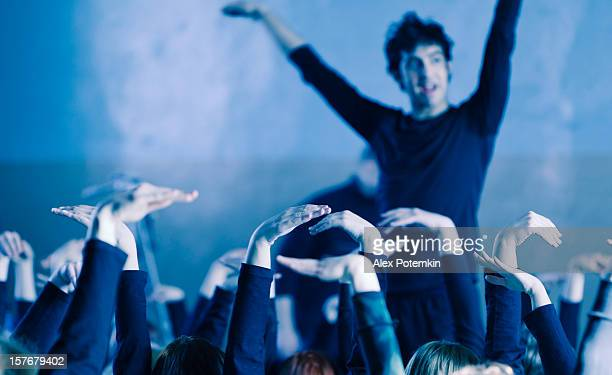 A picture of a man dancing in a crowd