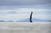 Picture of a person exercising upside down taken in Uyuni on September 18 2014 near the Salar de Uyuni salt pan the world's largest in Bolivia near...