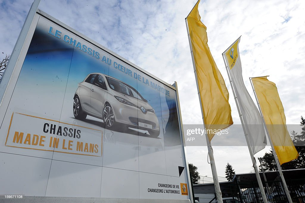 "Picture of a poster showing a Renault's car taken at the entrance of ""Auto Chassis International"" part of French group Renault, on January 16, 2013 in Le Mans, western France. French automaker Renault announce plans on January 15, 2013 to cut its staff in the country by 7,500 workers to become more competitive and prepare for the hiring of others with specific skills. Renault said it would shed 5,700 jobs by 2016 through natural attrition."