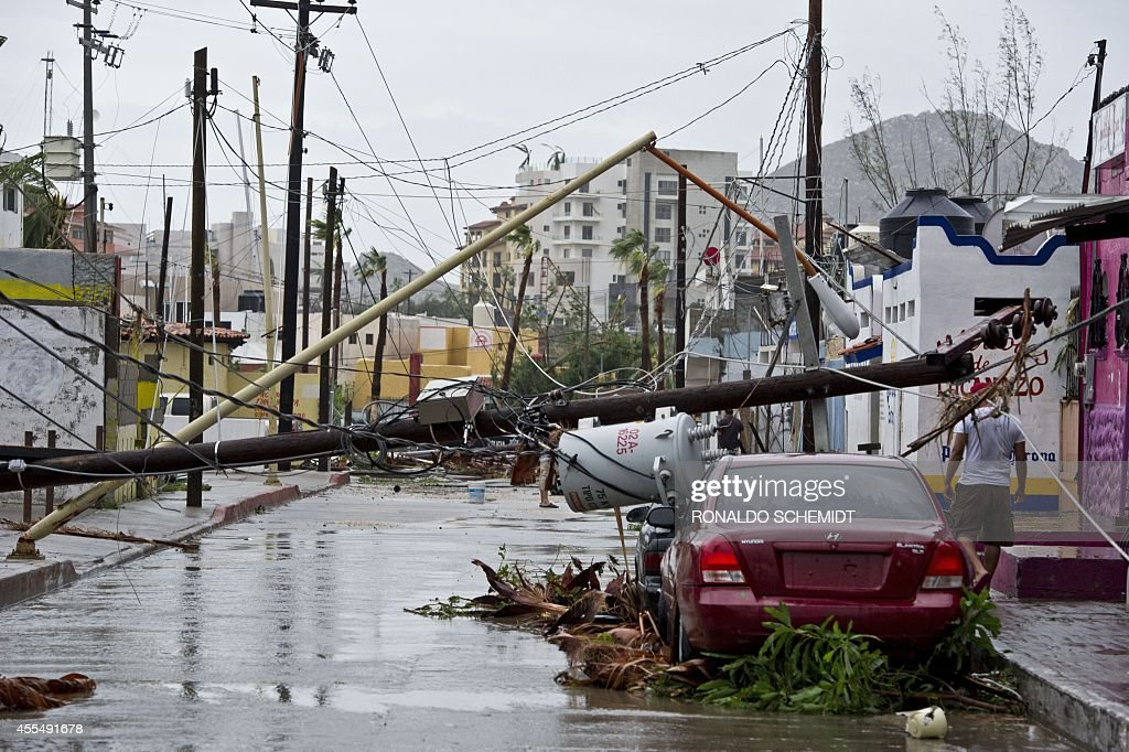 Picture of a street in Cabo San Lucas taken after hurricane Odile knocked down trees and power lines in this city in Mexico's Baja California...