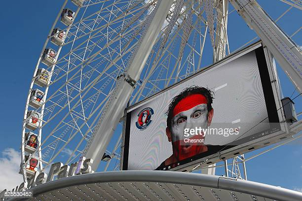 A picture of a supporter with the Austrian flag painted on his face is displayed on the ferris wheel on Place de la Concorde on April 28 2016 in...
