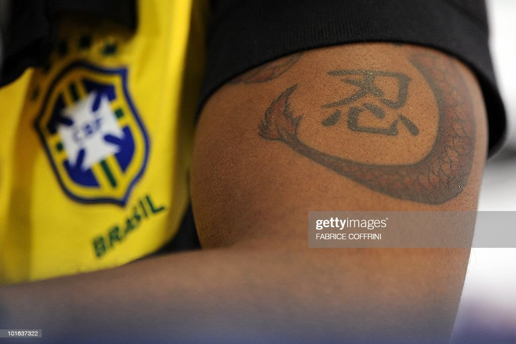 Picture of a tattoo on the arm of Brazil's football team player Grafite, taken during a press conference on June 5, 2010 in Johannesburg ahead of the start of the 2010 World Cup in South Africa.