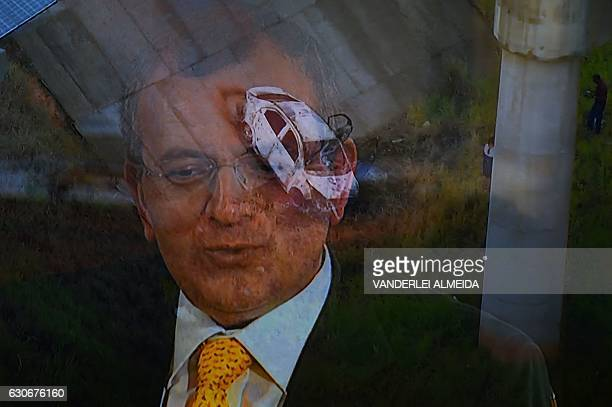 Picture of a TV set taken while TV Globo News shows the car and the face of Greek ambassador in Brazil Kyriakos Amiridis in Nova Iguacu Baixada...