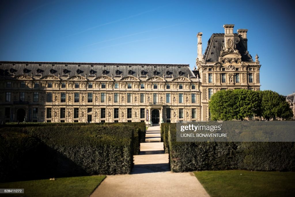 Picture of a wing of the Louvres museum at the Tuileries garden on May 5, 2016 in Paris. / AFP / LIONEL