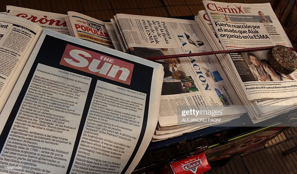 Picture of an advert placed in the Buenos Aires Herald by Britain's biggest-selling tabloid The Sun warning Argentina to keep its 'hands off' the Falklands, taken at a newsstand in San Telmo neighbourhood in Buenos Aires, on January 4, 2013. The Sun hit back at Argentina's President Cristina Fernandez de Kirchner's renewed claim over the disputed Falkland Islands in an open letter to her in the Buenos Aires Herald newspaper on Friday, a day after Fernandez de Kirchner published her own open letter in two British newspapers urging Britain to give up the South Atlantic islands. AFP PHOTO/ALEJANDRO PAGNI