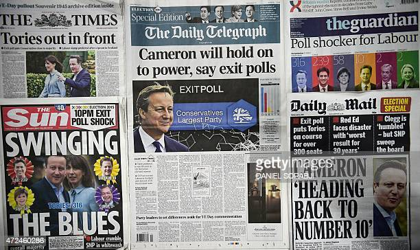 A picture of an arrangement of British newspapers carrying headlines dominated by exit poll forecasts in favour of the Conservative Party in the...