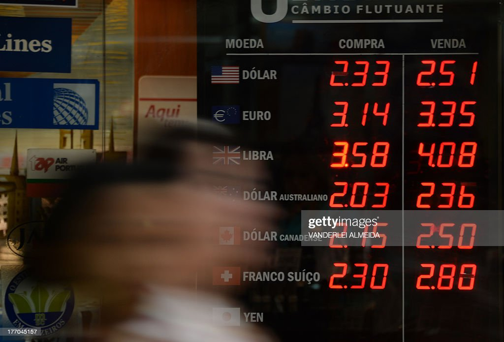 Picture of an exchange rate board on display at a bureau de change in Rio de Janeiro on August 20 2013 In the last six months the US dollar has...