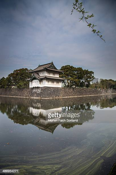 Picture of an old defensive tower and the moat surrounding the Imperial Palace in the Chuo Ward Tokyo Japan close to Tokyo Station One modern...