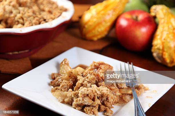 A picture of Apple crisp on a white plate