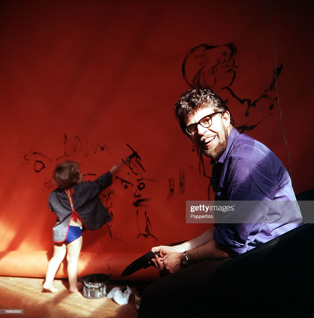 1967 A picture of Australian musician and entertainer Rolf Harris and his daughter painting a wall together