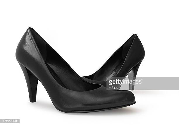 A picture of black leather high heeled pumps