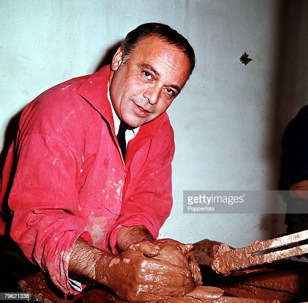 1967 A picture of British actor Herbert Lom working on a potters wheel with some clay