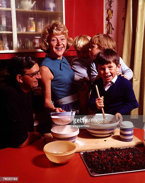1964 A picture of British actress Dora Bryan at home in the kitchen cooking with her family for her publication 'Dora Bryan's Cake Book'
