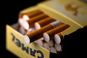 Picture of cigarettes taken on September 25 2014 in Paris France unveiled on September 25 a raft of new measures to crackdown on tobacco and...