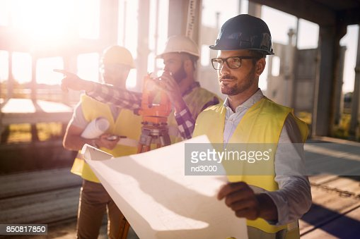 Picture of construction engineer working on building site : Stock Photo