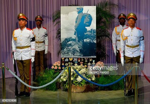 A picture of Cuban leader Fidel Castro his decorations and medals are guarded by soldiers during his tribute at Jose Marti's Memorial at Revolution...