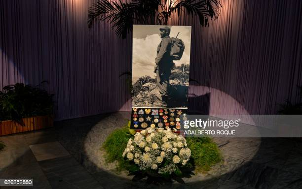 TOPSHOT A picture of Cuban leader Fidel Castro his decorations and medals are displayed during his tribute at Jose Marti's Memorial at Revolution...