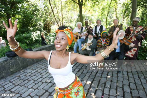 picture of dancer Lucy Hamandishe with members of The Dubliners and Kasai Masai playing together behind her Eamon Cambell Claude Bula Barney McKenna...