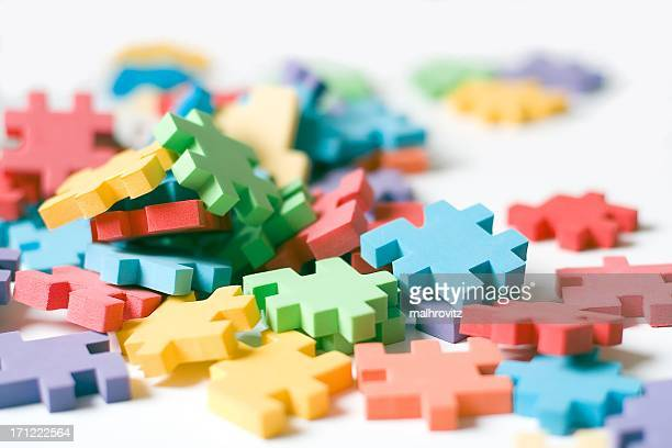 A picture of different color puzzle pieces