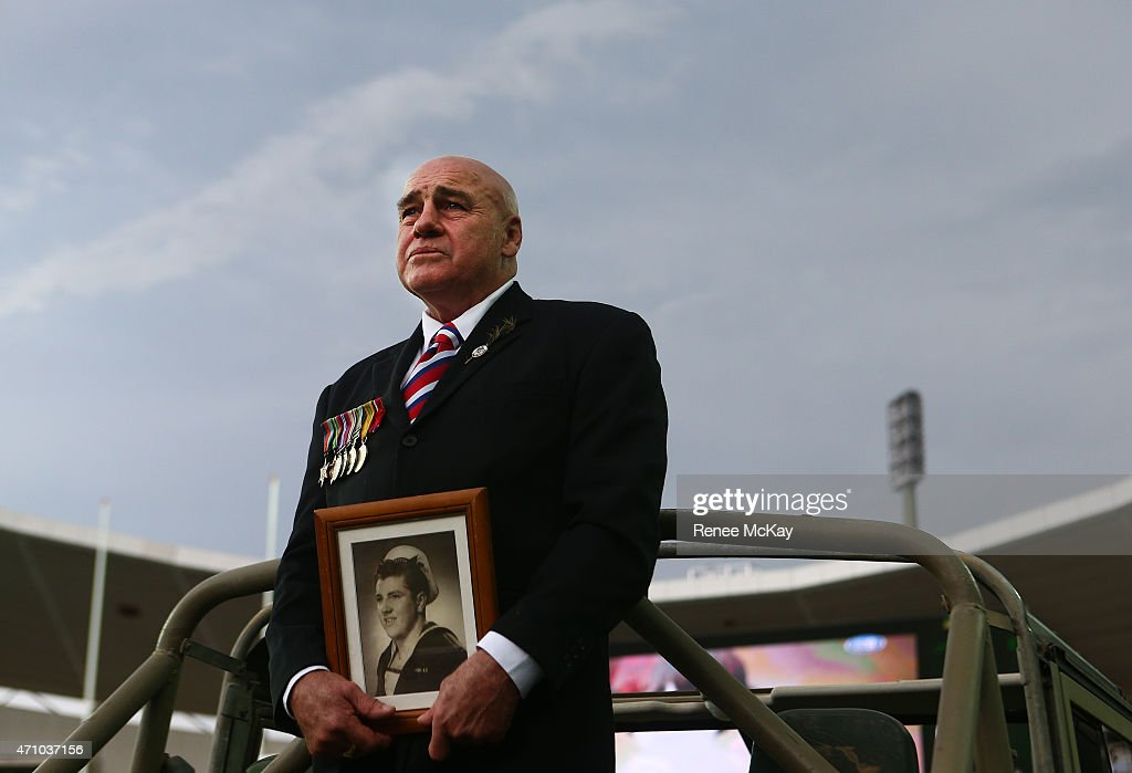 A picture of Ferris Ashton is held by his son Greg during the round eight NRL match between the Sydney Roosters and the St George Illawarra Dragons at Allianz Stadium on April 25, 2015 in Sydney, Australia.