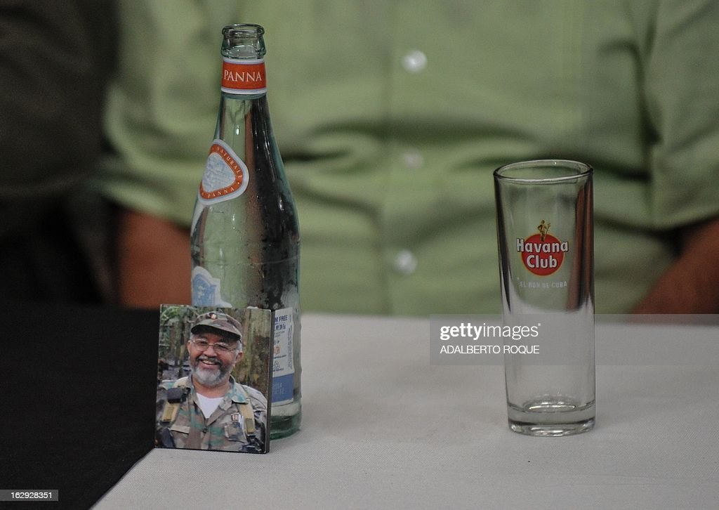A picture of former FARC-EP leftist guerrilla commander Raul Reyes, is seen in a press conference given by FARC-EP leftist guerrillas delegation at the Convention Palace in Havana on March 1m 2013.