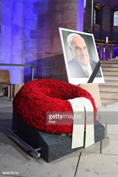 A picture of former German Chancellor Helmut Kohl on display next to a wreath of roses during a requiem for former German Chancellor Helmut Kohl at...