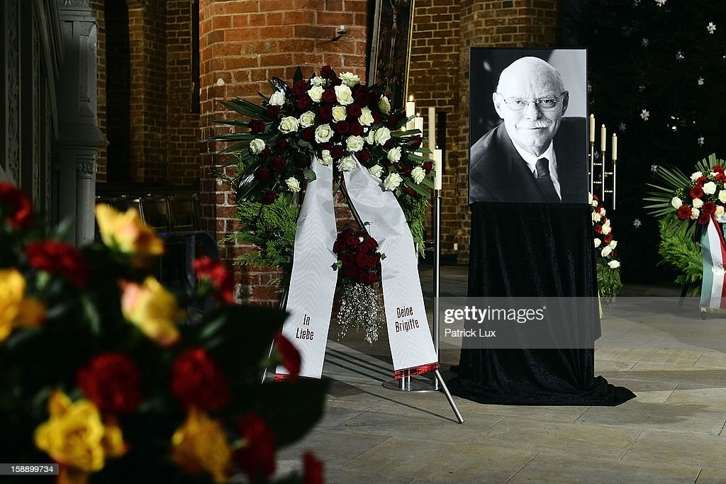 A picture of former German Defence Minister Peter Struck stands next to a chaplet from his widow at a memorial service on January 3, 2013 in Uelzen, Germany. Struck was a leading member of the German Social Democrats (SPD) and died in December following a heart attack.