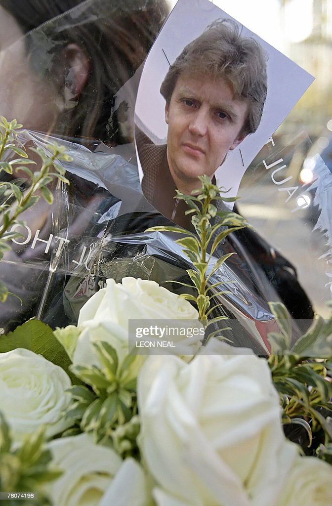 A picture of former Russian spy <a gi-track='captionPersonalityLinkClicked' href=/galleries/search?phrase=Alexander+Litvinenko&family=editorial&specificpeople=2926201 ng-click='$event.stopPropagation()'>Alexander Litvinenko</a> is pinned to flowers outside the University College Hospital in central London, 23 November 2007. The widow of murdered former KGB agent <a gi-track='captionPersonalityLinkClicked' href=/galleries/search?phrase=Alexander+Litvinenko&family=editorial&specificpeople=2926201 ng-click='$event.stopPropagation()'>Alexander Litvinenko</a> vowed to uncover the truth about alleged Kremlin links to her husband's poisoning Friday, the first anniversary of his death in London. With tears in her eyes, Marina Litvinenko told reporters afterwards: 'We need support, more official support, and I promise one day we definitely will know who is responsible for this because without this knowledge, we just cannot feel we're safe.' AFP PHOTO/LEON NEAL