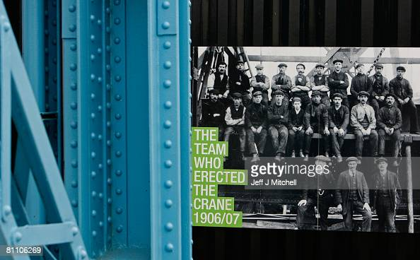 A picture of former workers hangs on a fence next to the Titan crane on May 16 2008 in Glasgow Scotland The world's first giant cantilever crane the...