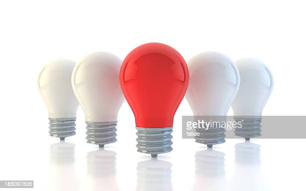 A picture of four white light bulbs and one white one