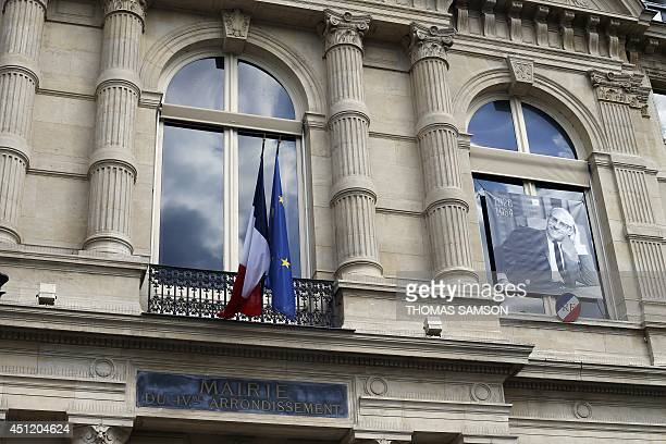 A picture of French philosopher Michel Foucault is seen on the city hall of the fourth Parisian district to mark the 30th anniversary of his death on...