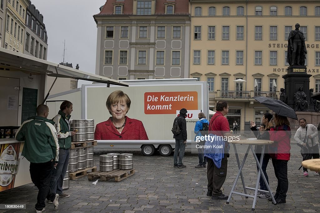 A picture of German Chancellor and Chairwoman of the German Christian Democrats (CDU) Angela Merkel is seen on a campaign truck after a CDU election campaign rally on September 15, 2013 in Dresden, Germany. Merkel has a strong lead over her political rivals and the CDU is expected to win federal elections scheduled for September 22