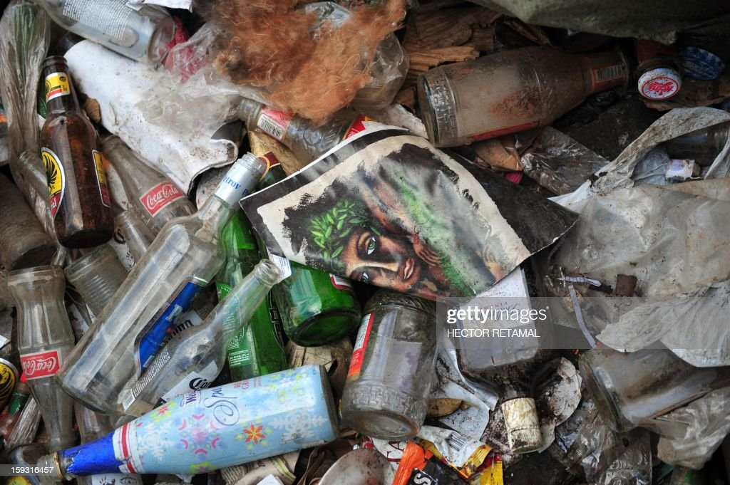 Picture of glass bottles and jars and other stuff taken at a landfill of Managua, on January 11, 2013. AFP PHOTO/Hector RETAMAL