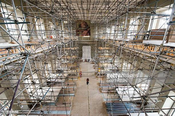 A picture of James 1st part of the ceiling painting under work hangs from the roof during restoration work at Banqueting House on March 1 2016 in...