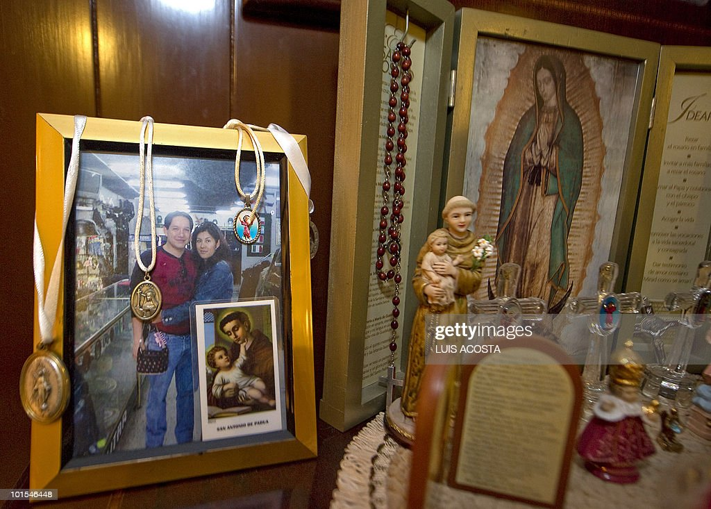 BARROS - A picture of kidnapped Jose Antonio Robledo is seen next to an altar to Our Lady of Guadalupe, in Mexico City on, May 20, 2010. Mexican engineer Jose Antonio Robledo was kidnapped 16 months ago and his parents regret having entrusted the case to the police. Like other family members of kidnapped Mexicans, they question the effectiveness of authorities. AFP PHOTO/Luis Acosta