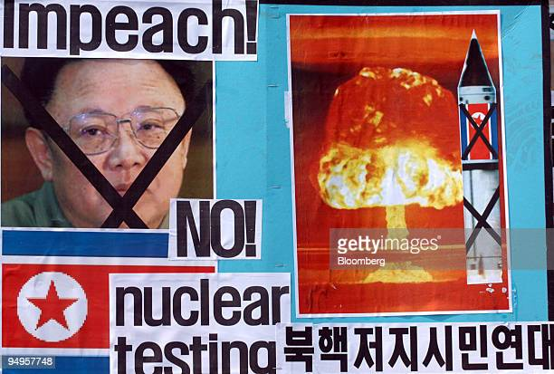 A picture of Kim Jong Il leader of North Korea and a nuclear misile are seen during a protest against North Korea's nuclear test and missile launch...