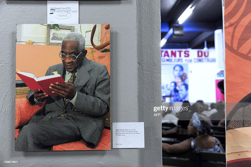 A picture of late French poet and politician Aime Cesaire is displayed on January 21, 2013 at the Martinican Progressive Party (PPM) headquarters in Fort-de-France, on the French Caribbean island of Martinique, marking the 100th anniversary of Cesaire's birth. Cesaire (June 25, 1913 – 17 April 2008) was former mayor of Fort-de-France and had funded the PPM party in 1958. As a pioneer of the black pride movement, Cesaire was a cult figure on his native island of Martinique and in the French-speaking world. With fellow writers such as Leopold Sedar Senghor of Senegal, 'Papa Cesaire' invented the term 'negritude,' which he defined as an 'affirmation that one is black and proud of it', decades before the emergence of Steve Biko or Martin Luther King.
