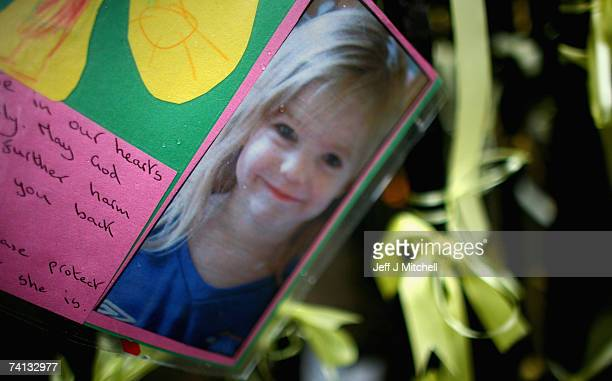 A picture of Madeleine McCann is tied to a post outside St Andrews Cathederal on May 12 2007 in Glasgow Scotland The three year old went missing from...
