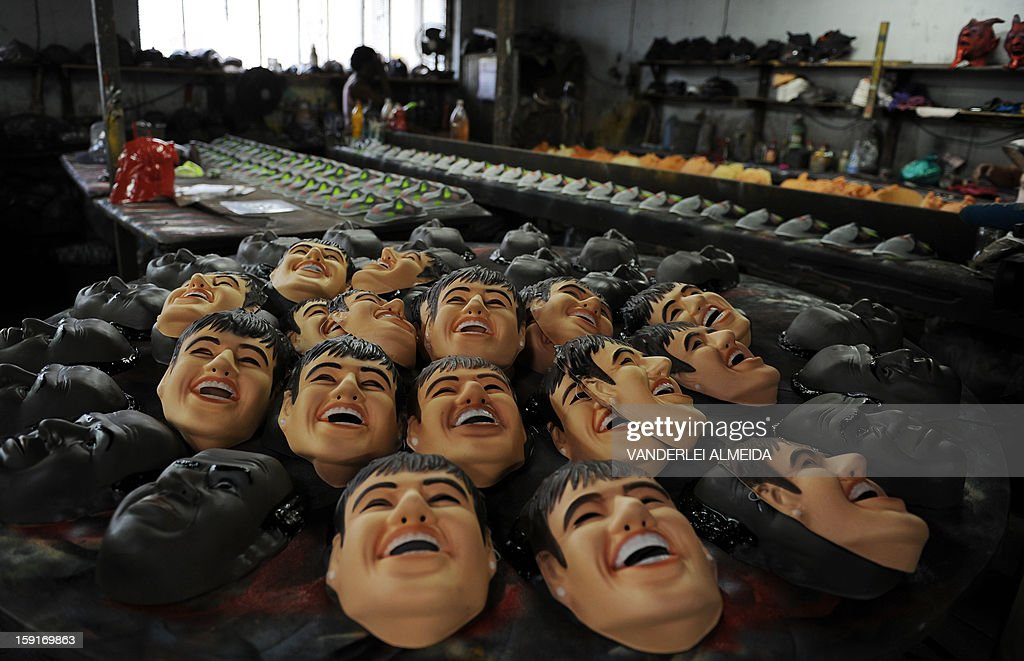 Picture of masks of Brazilian football star Neymar (C) and the president of the Brazilian Supreme Court Joaquim Barbosa taken at the carnival masks factory Condal, in Sao Gonçalo, about 35 km from downtown Rio de Janeiro, on January 9, 2013. Rio's world famous carnival takes place February 9-12.