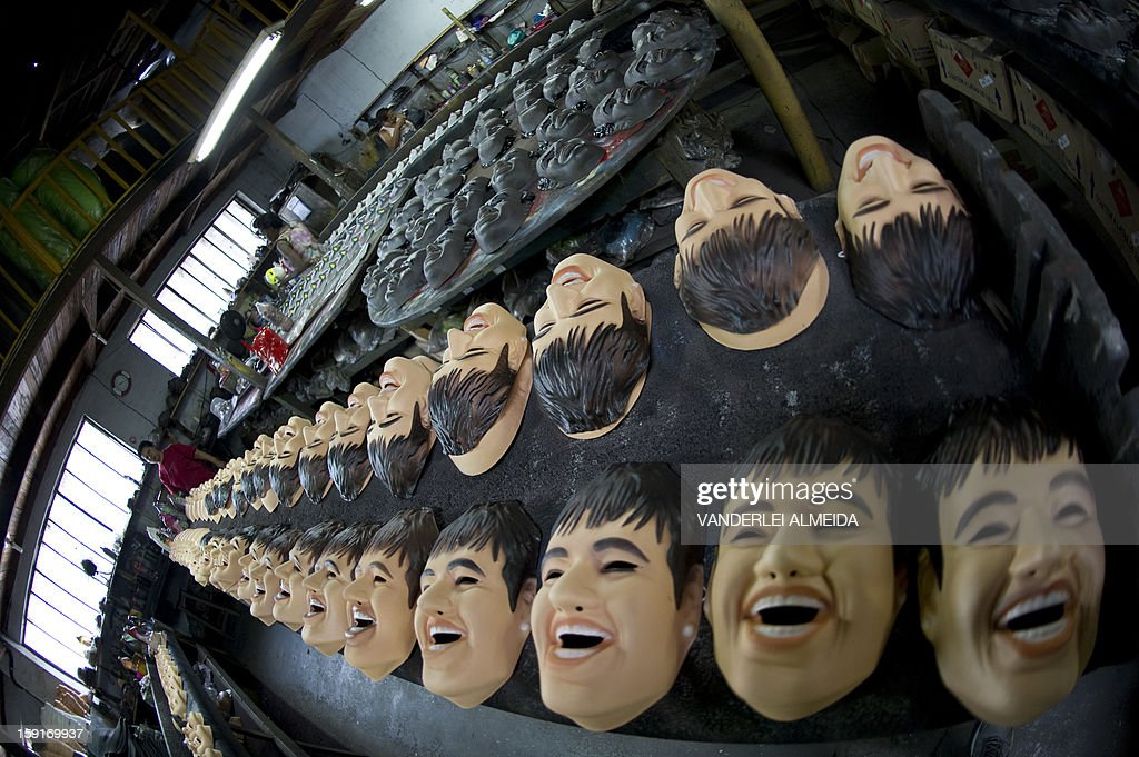 Picture of masks of Brazilian football star Neymar (foreground), taken at the carnival masks factory Condal, in Sao Gonçalo, about 35 km from downtown Rio de Janeiro, on January 9, 2013. Rio's world famous carnival takes place February 9-12.