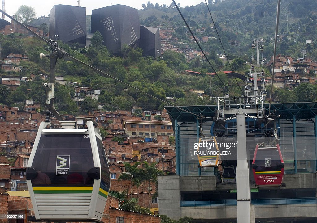 "Picture of Metrocable gondolas, seen in Santo Domingo Savio neighbourhood, in Medellin, Antioquia department, Colombia on March 1, 2013. Medellin, which competed with New York and Tel Aviv, was chosen by popular vote through the internet, as the ""Innovative City of the Year"" during the City of the Year contest, organized by The Wall Street Journal and Citigroup. The distinction was basically made for its modern transportation system, its public library, escalators built in a shantytown and schools that have allowed the integration of society. AFP PHOTO/Raul ARBOLEDA"
