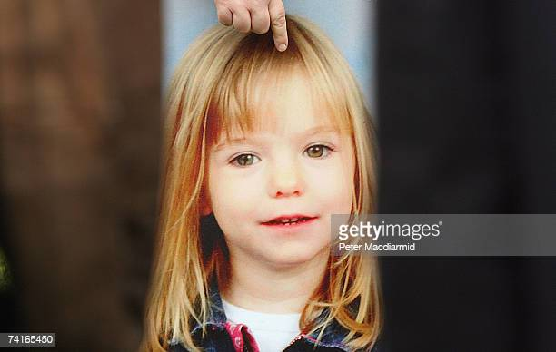 A picture of missing toddler Madeleine McCann is held by her aunt Philomena McCann as she gives television interviews after visiting Parliament on...