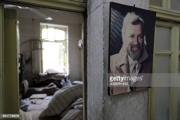TOPSHOT A picture of Mohammed Mohiedin Anis or Abu Omar hangs in his house in Aleppo's formerly rebelheld alShaar neighbourhood on March 9 2017 / AFP...