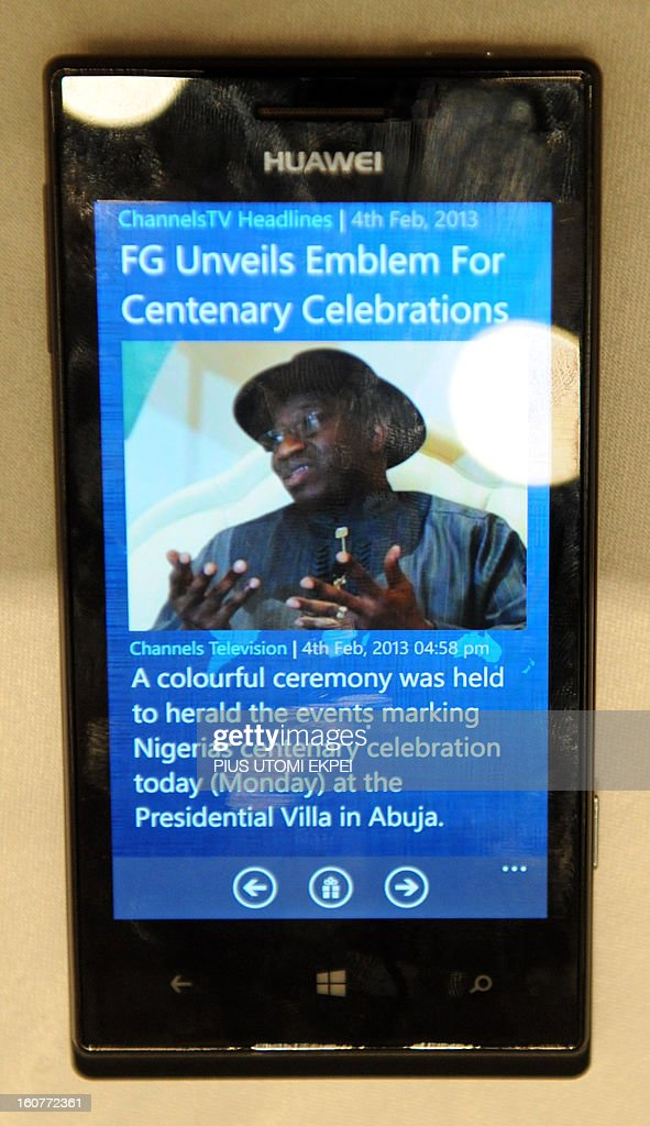 A picture of Nigerian President Goodluck Jonathan is displayed on Huawei 4Afrika, a full functionality Windows Phone 8 pre-loaded with select applications designed for Africa launched in Lagos on February 5, 2013. Microsoft Corporation has introduced the Microsoft 4Afrika initiative, a new effort through which the company will actively engage in Africa's economic development to improve its global competiveness. AFP PHOTO/PIUS UTOMI EKPEI