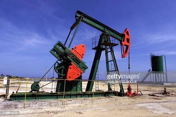 Picture of oil field pumps taken 28 July 2004 in Santa Cruz del Norte in Havana Cuba which has been in dire economic straits since the collapse of...