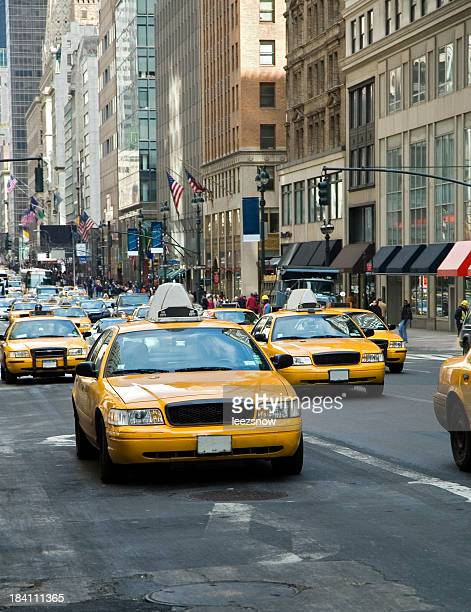 picture of oncoming yellow taxi cabs in New York