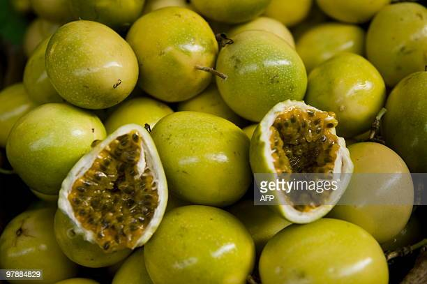 Picture of passion fruits for sale at the wholesale fruit market in Lima on March 19 2010 AFP PHOTO/Ernesto Benavides