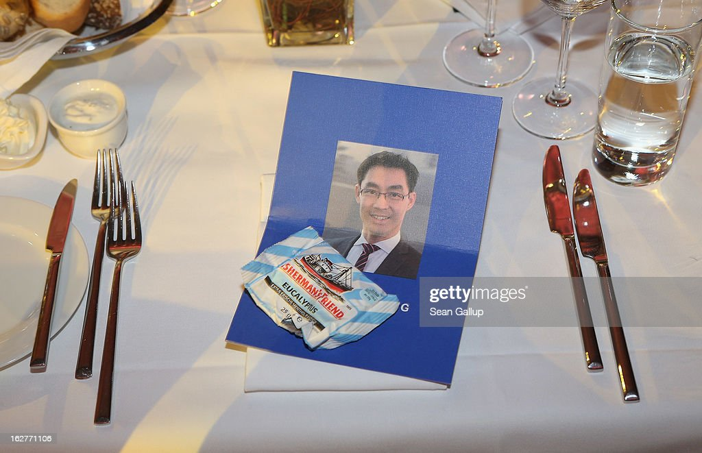 A picture of Philipp Roesler, Vice Chancellor and Chairman of the German Free Democrats (FDP), lies on a table at his 40th birthday celebration on February 26, 2013 in Berlin, Germany. The FDP and CDU are the two members of the current German government coalition, though the FDP has faced a very challenging last 18 months that has brought the party to its lowest popularity ratings in decades. Germany faces federal elections in September.