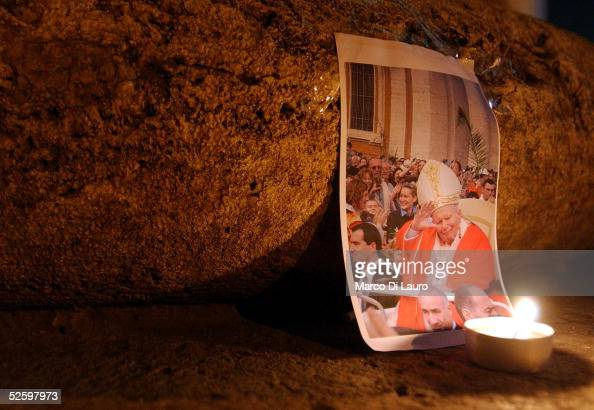 A picture of Pope John Paul II is seen in the early hours of April 7 2005 in Rome The body of Pope John Paul II will lie in state in Saint Peter's...